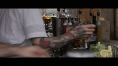 tattooed bartender giving drink to customer CU - stock footage