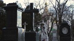 Granite tombstones on the bleak cemetery - stock footage