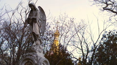 Angel with wings on the background of the old Church - stock footage