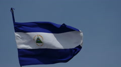 National flag of Nicaragua at bleu sky - stock footage