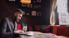 Man using an advanced personal e-cigarette and used tablet Stock Footage