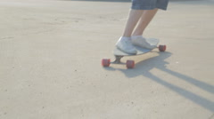 Long board rider passing by camera fast Stock Footage