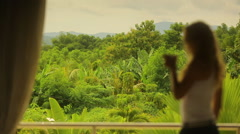Women looking into the jungle Stock Footage