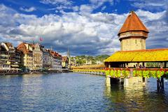 Lucerne, Switzerland, wooden Chapel Bridge and Water tower - stock photo