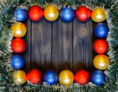 New year theme: christmas decoration and balls on dark retro stylized wood ba Stock Photos