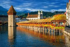 Lucerne, Switzerland, Chapel Bridge, Water Tower, Jesuit Church skyline on su - stock photo
