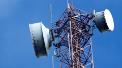 Signal transmitters on the tower under the cloud Stock Footage