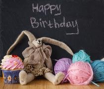 Handwriting message on chalk board with felt doll - stock photo