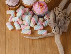 Handmade rabbit doll with heap of sweets Stock Photos