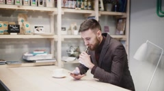 Man using an advanced personal e-cigarette and used phone Stock Footage