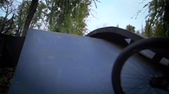 Boy going airborne bmx jump. Slow motion 400fps in city park Krasnodar EDITORIAL - stock footage