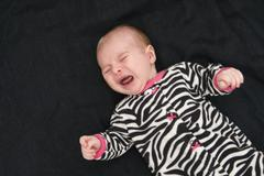 Portrait of crying baby - stock photo