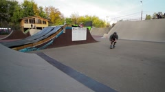 Skater jumps high on ramp Slow motion 400fps in city park of Krasnodar EDITORIAL - stock footage