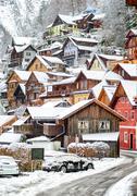 Wooden houses in Hallstatt, austrian alpine village by Salzburg, Austria - stock photo