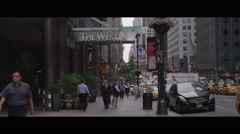 The Westin New York side view pedestrians pass by Stock Footage
