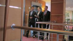 Colleagues finished meeting and go along the corridor of office building Stock Footage