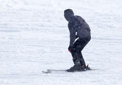 Stock Photo of Athlete skiing in the snowy mountains