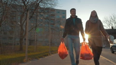 Man and woman returning home after shopping Stock Footage