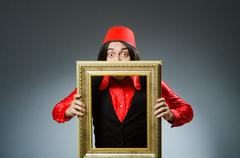 Stock Photo of Man wearing red fez hat