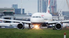 Aircraft Taxis At City Airport Stock Footage