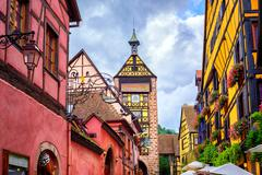 Colorful houses on a central street in Riquewihr, village on wine route in Al Stock Photos