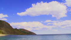 Magic Cloudscape Over Sea And Mountains Stock Footage