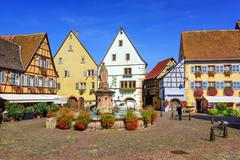 Colorful half-timbered houses in Eguisheim, Alsace, France - stock photo