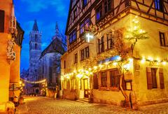 Christmas decoration lights at night in Rothenburg ob der Tauber, Germany - stock photo