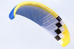 Parachute flying in the sky Stock Photos