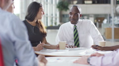 4K Attractive mixed ethnicity business group discuss ideas in office meeting Stock Footage