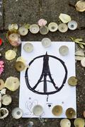 Stock Photo of Messages, candles and flowers in memorial for the victims