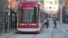 Toronto public transit new and old streetcars on spadina avenue - stock footage