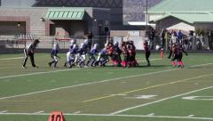 2741 - youth football, PeeWee, Pop Warner, quarterback runs left for touchdow - stock footage