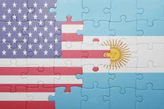 Stock Photo of puzzle with the national flag of united states of america and  argentina