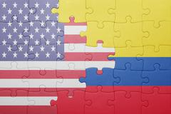 puzzle with the national flag of united states of america and  colombia - stock photo