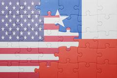 Stock Photo of puzzle with the national flag of united states of america and chile