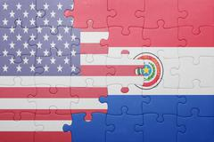 Stock Photo of puzzle with the national flag of united states of america and paraguay