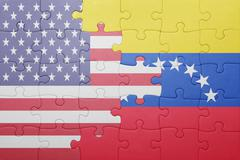 puzzle with the national flag of united states of america and venezuela - stock photo