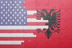 Stock Photo of puzzle with the national flag of united states of america and  albania
