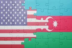 puzzle with the national flag of united states of america and azerbaijan - stock photo