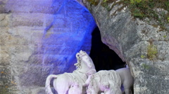 A white statue of men and horse on the fountain Stock Footage