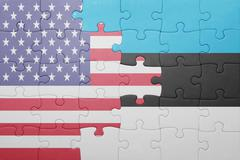 Stock Photo of puzzle with the national flag of united states of america and  estonia
