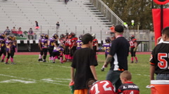 2739 - youth football, PeeWee, Pop Warner, the coach watches his players Stock Footage