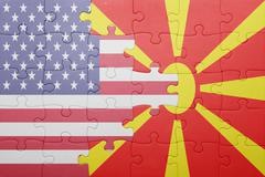 Stock Photo of puzzle with the national flag of united states of america and macedonia