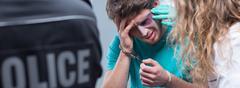 Handcuff bruised man Stock Photos