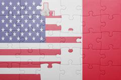 puzzle with the national flag of united states of america and malta - stock photo