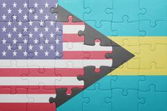 puzzle with the national flag of united states of america and  bahamas - stock photo