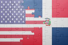 puzzle with the national flag of united states of america and dominican repub - stock photo