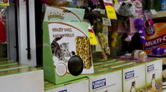 Woman buying Pawise crazy ball for cat inside London drugs store Stock Footage