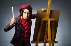 Stock Photo of Funny artist with his artwork